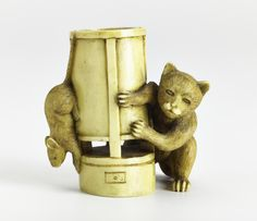 Netsuke of carved ivory, a cat chasing a rat round a lamp, unsigned: Japan