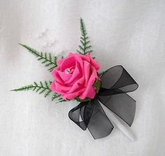 1 SINGLE ROSE BUTTONHOLES IN HOT PINK ROSES WITH BLACK RIBBON WEDDING FLOWERS