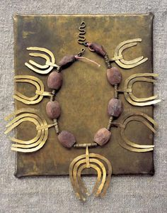 ALEXANDER CALDER, Necklace, Material ebony, brass, brass wire and brass washers on cord. Image from the book Calder Jewelry Contemporary Jewellery, Modern Jewelry, Metal Jewelry, Jewelry Art, Antique Jewelry, Vintage Jewelry, Handmade Jewelry, Jewelry Necklaces, Jewelry Design