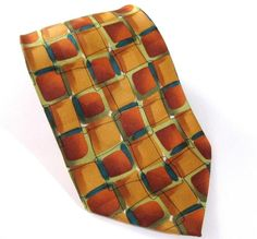 Jerry Garcia New York Night Silk Neck Tie Coll Thirty Eight. Jerry Garcia's music as lead guitar, singer and songwriter for the Grateful Dead has been enjoyed for decades by people of all ages.  Also an accomplished visual artist , Jerry created the J. Garcia neckwear line, overseeing this unique use of his art.  Each design is based on one of Jerry's paintings or drawings.  This line continues the tradition of quality and value, celebrating his artistic legacy and vision. $13.50