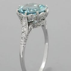 Aquamarine Engagement Ring... but with an emerald.