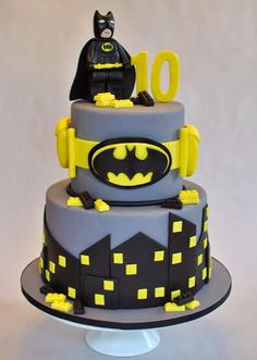 Cool lego batman cake - Love the bat belt design on the second layer and the city scape on the bottom.