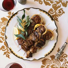 Marinating lamb kebabs in yogurt makes them extra tender, and basting the meat with lemon butter just before serving adds an extra layer of bright flavor.