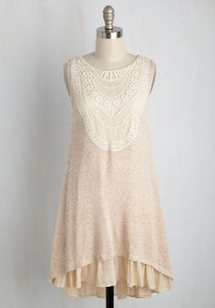 The illustration of a go-with-the-flow attitude, this knit shift dress sways with stylish ease. Even its ivory and warm beige hues are laid-back! Embodying a boho-inspired appearance with its crocheted yoke, and romantically tiered at the high-low hemline, this back-tied look clothes your smiling spirit with a lighthearted sense of loveliness.
