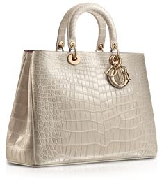Dior bags are classic and well made. They are worth the price and can be carried with everything.