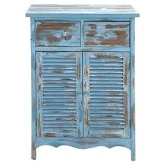 """At home in a country cottage or coastal retreat, this charming wood cabinet showcases 2 drawers, 2 louvered doors, and a distressed finish.    Product: CabinetConstruction Material: Wood and metalColor: Distressed blue and brownFeatures:  Two drawersTwo louvered doors Dimensions: 40"""" H x 28"""" W x 16"""" D"""