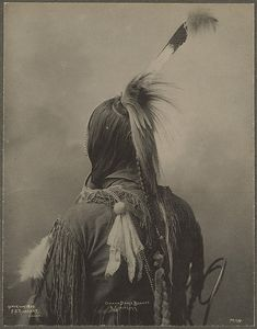 Interesting and unusual photographic perspective of Omaha Dance Bonnet & Scalp Lock photographed by F.A. Rinehart in 1898 in Omaha, Neb. at Trans-Mississippi and International Exposition.