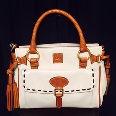 Dooney & Bourke Medium Pocket Bag White CUTE!!! Dooney & Bouke Florentine Medium Pocket Satchel, white and natural color. New with tags. The leather is very posh and nice. Comes with signature blue D&B dust bag and detachable shoulder strap. Tag says $318. Get this gorgeous leather bag for a steal!!! Dooney & Bourke Bags Satchels