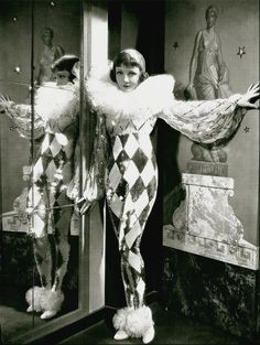 1930s photo of Claudette Colbert as a harlequin