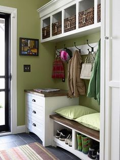 A great way to use a little area by your entrayway. Love the repurposed mini dresser (store off weather gloves, hats, scarves, doggie clothes...) and the shoe storage.
