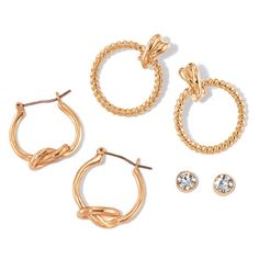 """Set of three pairs of earrings featuring studs and 2 pairs of hoops. Studs have a clear faceted rhinestone. Other pairs are hoops; one has a knot on the bottom and the other is braided with a knot at the top. A pair for every occasion!Pioneer Collection: This collection of knot-like designs and rhinestone sparkle adds the perfect sophisticated touch for everyday wear.FEATURES• Knot earrings: 3/4"""" diam. x 1"""" L; knot is 1/2"""" L x 3/8"""" W• Braided earrings: 3/4"""" diam. x 1 1/8"""" L; 1/2"""" L..."""