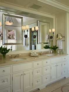 Amazing master bathroom features custom cream double vanity with crema marble countertops and his and her sinks.