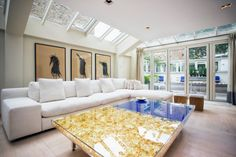 Two Yves Klein tables take centre stage in this open-plan living room