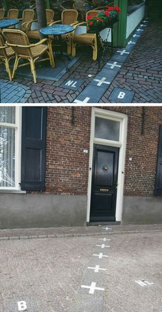 Border between The Netherlands and Belgium marked by street signs that split houses and neighborhoods right down the middle