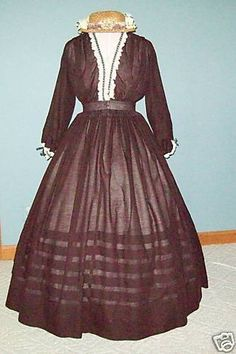 1860s extant sheer dress with tucks in the skirt and a pretty v-neck