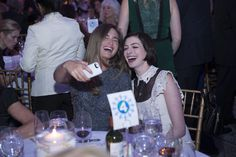Lauren Bush Lauren and Anne Hathaway take a selfie at the Awards Ceremony