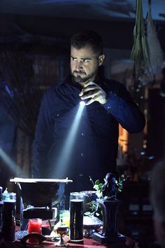 Nick Stokes (George Eads) looks up briefly while he searches the home of chemistry teach Chet Messner after his science experiement went horribly wrong, on CSI: CRIME SCENE INVESTIGATION, Sunday, Oct. 19 (10:00-11:00 PM, ET/PT) on the CBS Television Network. Photo: Michael Yarish/CBS ©2014 CBS Broadcasting, Inc. All Rights Reserved