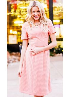 Cute, feminine textured modest dress in peach and perfect for dressing up! Total Length: XS-S 40.5 , M-L 41 , XL-2XL 41.5  Colors: Navy, Hot Pink, Peach Fabric: 95% Polyester 5% Spandex, Fully Lined Care: Machine gentle wash, Hang Dry