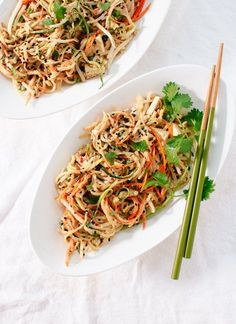 Light, healthy spin on pad Thai using raw vegetable noodles instead of rice noodles! Savory peanut sauce makes this salad-y dish irresistible. Gluten free.