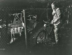 Michael Caine walks a bike. Stealthily.