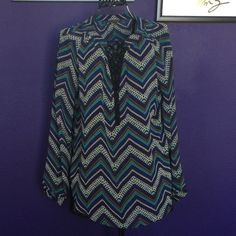 Chevron Tunic Fun boutique sheer tunic with brown, white, and blue chevron print.  V neck button detail.  Lightly loved.  Looks great with skinny jeans or leggings! Tops Tunics