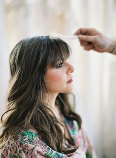 "A tip from Dove® Hair celebrity stylist Mark Townsend: ""To tame pesky flyaways—or give bangs a little, ahem, guidance — mist a natural-bristle toothbrush with hairspray"