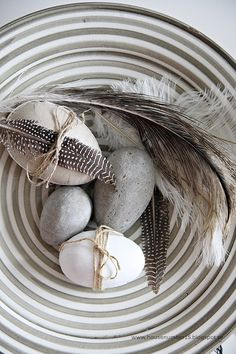 Very artsy eggs & feathers in a gorgeous ceramic bowl