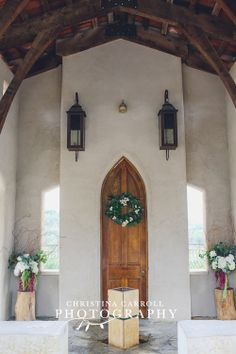 love the simplicity of the arrangements and the wreath. perfect for this chapel