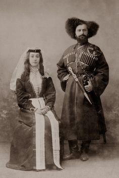 Georgian costumes. I can't get over his dramatic hairstyle. :-)