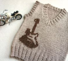 Children hand knitted wool vest, Knitted Baby Toddler Vest, Boy beige vest with guitar, Tank top for boy Beige and brovn Hand knitted toddler vest with guitar print embroidery. Made from soft and light weight Baby Wool Yarn. Baby Boy Sweater, Hand Knitted Sweaters, Boys Sweaters, Wool Vest, Knit Vest, Baby Boy Knitting Patterns, Hand Knitting, Start Knitting, Sweater Patterns