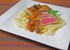 Ahi Tuna Over Pasta with Olive, Basil and Tomato Sauce http://tomandanitamorgan.blogspot.com/2014/02/ahi-tuna-over-pasta-with-olive-basil.html