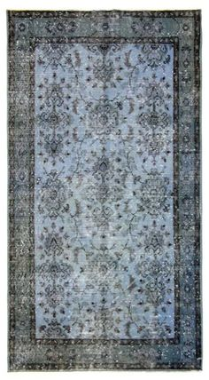 Bring in warm indigo tones with this Turkish overdyed rug.