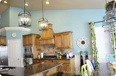 Blue Kitchen transformation at All Things Thrifty! Sherwin Williams Raindrop.