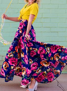 with bold colors, you're sure to stand out. This wrap skirt has a button to fasten the skirt together + a side tie for extra cuteness - shop this style at shopluckyduck.com