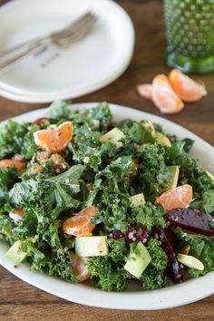 Superfood Salad - -   I'm resetting my diet. Which starts with this superfood salad. And this one is loaded with so many different superfoods it's going to rock your world.  Piled high with kale, mandarins, quinoa, beets, avocados, almonds and dried cranberries this salad will keep ya going all day long.    http://whatsgabycooking.com/superfood-salad/#.UuckT39OKSM