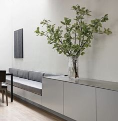 Clean & minimal breakfast nook with built-in bench; Use as shelf and seating area instead of railings