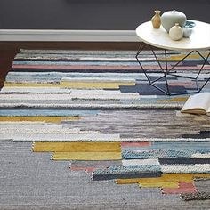 Pixilated pattern. Inspired by a 1970s wall hanging, our Multi Pixel Rug is handwoven by Craftmark-certified artisans in India using yarns of varied texture and colour.