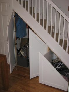 Use the wasted space under the first few stairs--just put in understairs storage