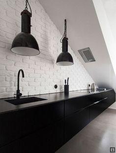 white bricks+black kitchen