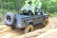 Land Rover Defender 110 Td5 soft top in mud