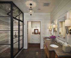 Black framed shower.  Horizontal grain marble shower