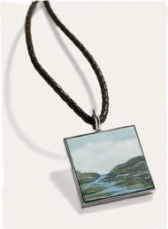 A sterling bezel frames an exquisite original oil painting on wood by Nell Mercier. Suspends from an adjustable braided leather cord with sterling clasp.