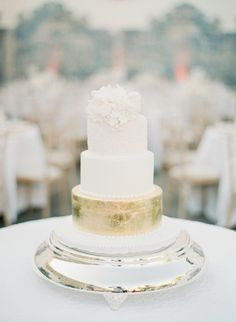 White cake with gold stand | Photography: Greg Finck Photography - www.gregfinck.com