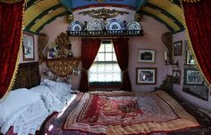 gypsy caravan bed  ... I love this, absolutely...BUT - I'd wake up and see myself in the mirror and scare myself half to death, throw my arms around and break all those little pretties and, well, it certainly wouldn't be pretty.... sign...just the facts of life, I guess...