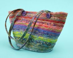 """Bali Bag: """"I'm a big fan of batiks, so when I saw this pattern I knew I had to make it,"""" assistant editor Jody Sanders says. """"Clothesline covered with 2-1/2""""-wide strips of batiks is the secret to this bag. After the clothesline has been covered, the bag is constructed. To get a jump-start, use pre-cut strips such as Bali Pops by Hoffman Fabrics or Jelly Rolls by Moda Fabrics."""""""
