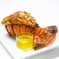 How to Butterfly Lobster Tails Butterflying a lobster tail means to cut open the hard top shell through the meat. This is easy to do and helps the meat cook evenly. Plus, the cooked lobster meat puffs up and over the shell, giving the tail a showy restaura