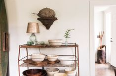 "A collection of vintage ceramic mixing bowls make a great display on this wire rack in the kitchen. See the full home tour and read all the insider tips on ""Rustic Meets Refined: 7 Lessons from Designer James Huniford"" over on our Style Guide! American Interior, Style Rustique, Tabletop Accessories, Interior Decorating, Interior Design, Love Home, Rustic Style, House Tours, Small Spaces"
