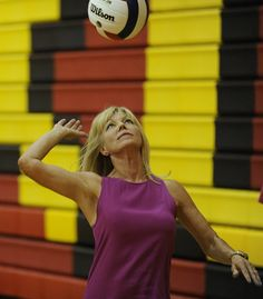 Schaumburg's coach Jeanette Pancratz warms up her players before the Saxons' victory over Conant.