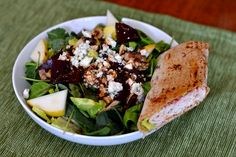 greens, pears, blue cheese, walnuts, dried cranberries, beets, and avocado with honey balsamic + half of a turkey wrap