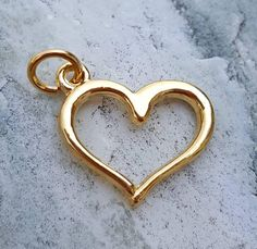 Excited to share the latest addition to my #etsy shop: 14k gold plated open heart charm, heart pendants jewelry, charm bracelet necklace, floating heart charm pendant jewelry, yellow gold heart #charms #charmbracelet #floatingheartcharm #heartcharms #lovejewelry #goldheart #goldcharms #heartpendants http://etsy.me/2z9qUg0